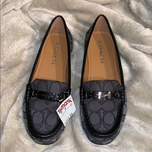 Coach signature loafers.